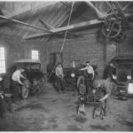 Students_at_work_in_auto_repair_shop_-_NARA_-_285366